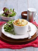 Ham and cheese soufflé with mixed lettuce