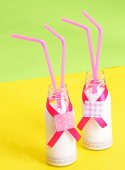 Bottles of milk with drinking straws for a children's party