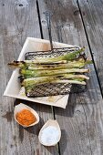 Grilled spring onions with pepper salsa