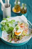 Toasted bread topped with green asparagus and a poached egg