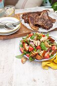 Grilled asparagus bread salad and grilled T-bone steaks