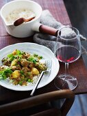 Indian lamb curry with potatoes and peas on a bed of rice