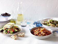 Greek salad, braised beans and peas, lamb and artichoke fricassee