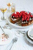 Chocolate and hazelnut cake with espresso ganache and fresh raspberries, sliced