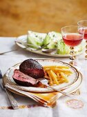 Stuffed fillet steak with fries