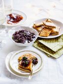 Anchovy and onions pastries with tapenade and bresaola