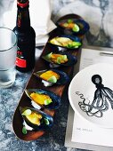 Mussels with a saffron vinaigrette and a long wooden dish