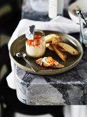 Taramasalata (fish roe cream) with salmon caviar and baguette slices