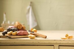 Assorted potatoes on a chopping board