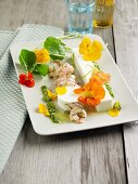Yoghurt jelly with brown shrimps, pesto and nasturtium flowers
