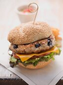 A chicken and blueberry burger