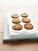 Anzac biscuits on a baking-paper covered wirerack