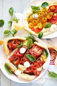 Puff pastry tart with tomatoes, mozzarella and ricotta