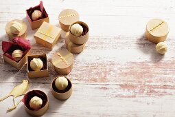 White chocolate pralines in little wooden boxes