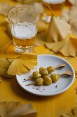 Gingko nuts on skewers and a glass of beer