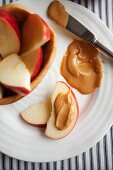 Pieces of apple with peanut butter