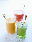 Three differently coloured tomato smoothies