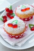 Cupcakes decorated with cherry jelly sweets