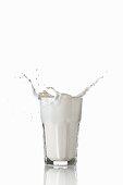 Milk splashing out of glass