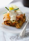 A courgette cake topped with smoked salmon and lime creme fraiche