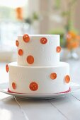 Two-tier almond layer cake with vanilla buttercream icing