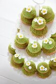 Religieuse with pistachios and sugar flowers (France)