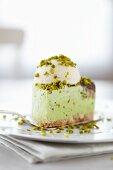 Pistachio torte with a scoop of ice cream