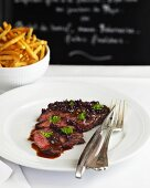 Steak with shallots and skinny chips