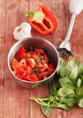 Ingredients for gazpacho: red pepper, capers, garlic, basil