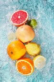 Assorted citrus fruits in water