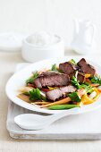 Lamb steak with hoisin sauce and vegetables (China)