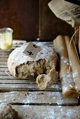 Rye bread, broken open, on a floury surface