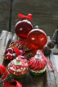 Assorted Christmas tree decorations: red baubles and muffins