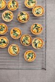 Mini spinach quiches on a wire rack