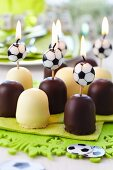 Football candles in chocolate marshmallows