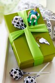 Present decorated with football lolly and other football-themed ornaments