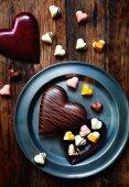 Heart-shaped chocolates with a heart-shaped chocolate box