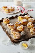 Saffron tartlets with oranges on a baking tray