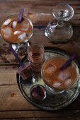 Two iced coffees with chocolate shooters