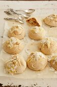 Vanilla macaroons decorated with white chocolate and grated coconut