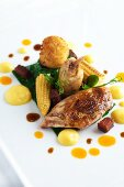 Fried quail with baby sweetcorn, spinach and croquettes