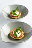 Canapés with smoked salmon, sour cream and herbs
