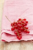 Redcurrants on a pink cloth