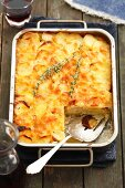 Potato gratin with thyme in the baking dish