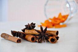 Assorted flavourings for mulled wine (orange peel, star anise, cinnamon sticks)