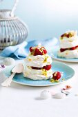 Coconut pavlova with sweetened cream filling and strawberries