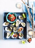Oysters with a watermelon & cucumber relish and limes