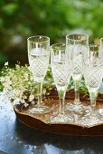 Crystal Champagne Glasses on a Tray; Filled with Prosecco