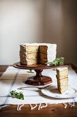 Rosemary Corn Cake with Brown Butter and Honey Buttercream Frosting with a Slice Plated