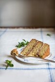 A Slice of Rosemary Corn Cake with Brown Butter and Honey Buttercream Frosting